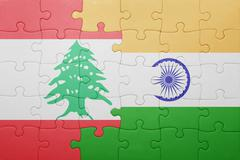 Puzzle with the national flag of india and lebanon Stock Photos