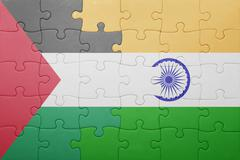 puzzle with the national flag of india and palestine - stock photo