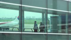 Anonymous people in airport boarding disembark travel airplane baggage 4k Stock Footage