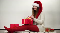 Woman wrapping gift present tying ribbon bow 4K. Stock Footage