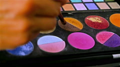 Palette of colorful eyeshadow. Make-up artist doing make-up. - stock footage