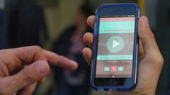 4K Close up of hand holding a smartphone with application on screen outdoors Stock Footage