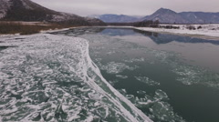 Aerial - Scenic mountain landscape with flying over the frozen river 4K Stock Footage