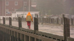 Walking on the Wharf in the Rain. Stock Footage