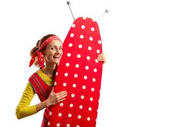 Smiling housewife with ironing-board Stock Photos