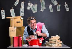 Happy businessman is laundering money - stock photo
