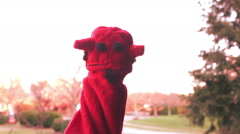 Devil puppet laughing laugh outside Stock Footage