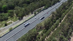 Pan Left Aerial of Trucks on Australian Highway - stock footage