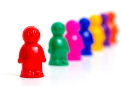 Colorful toy people standing in a queue - stock photo