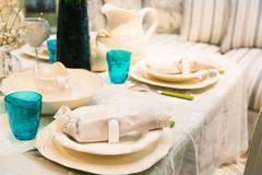 Served fashion table with glases and plates - stock photo
