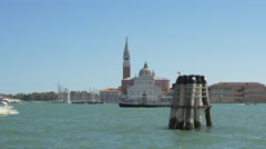 Boats passing by the Church of San Giorgio Maggiore, Venice Stock Footage