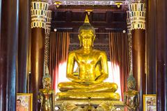 Golden buddha statue at Temple in Chiang Mai - stock photo