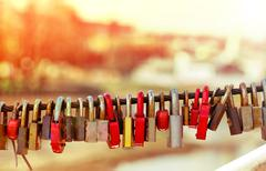 Old padlocks on bridge railing Stock Photos