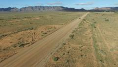 Aerial footage of vehicle (car) traveling off-road in outback Stock Footage