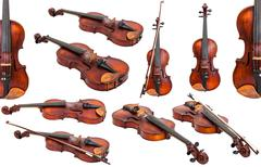 set of old fiddles isolated on white - stock photo