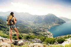 Pretty traveler woman with backpack on a mountain Stock Photos