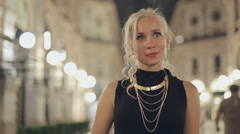 Enthusiastic girl in downtown of Milan at night Stock Footage