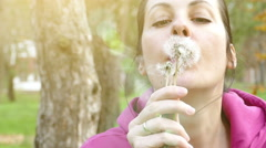 Blowing Dandelion in Nature in Slow Motion Stock Footage