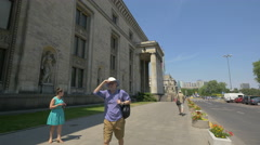 Tourists walking by the Palace of Culture and Science, Warsaw Stock Footage