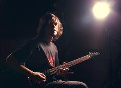 Guitarist play on the electric guitar Stock Photos