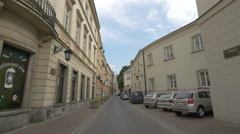Cars parked near the Irish Pub on Kozia street in Warsaw Stock Footage
