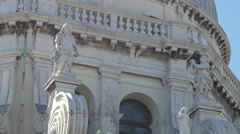 Three statues on Basilica di Santa Maria della Salute in Venice Stock Footage