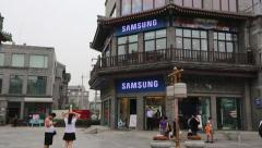 Front Gate and Samsung store of the Qianmen shopping Street, Beijing Stock Footage