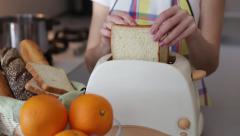 Woman hands making toasts. Toaster in work. - stock footage