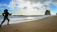 The Great Ocean Road, Woman running at the beach Stock Footage