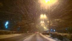 Stock Video Footage of Heavy snowfall falling on the city streets at night