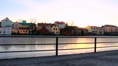 Buildings near the frozen river in Eskilstuna city, Sweden rr Stock Footage