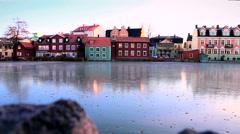 Buildings near the frozen river in Eskilstuna city, Sweden rr - stock footage