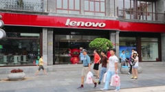 Lenovo store is on a shopping pedestrian Qianmen street in Beijing - stock footage