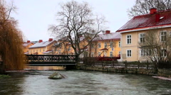 Stock Video Footage of Roofs of houses covered with snow near a river in Eskilstuna RR