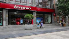Lenovo store is on a shopping pedestrian Qianmen street in Beijing Stock Footage