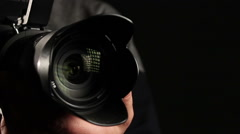 cameraman focuses the lens - stock footage