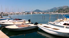 Fishing boats anchored in the marina Stock Footage