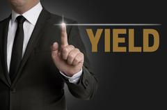 Yield touchscreen is operated by businessman concept Stock Photos