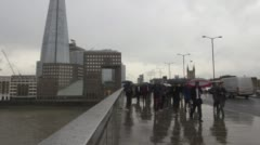 time-lapse video commuters crossing London bridge during morning rush hour wi - stock footage