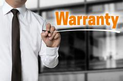 Warranty is written by businessman background concept - stock photo