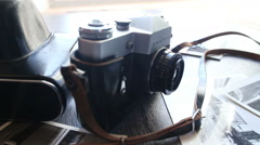 Old camera on a wooden table - stock footage