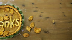 Homemade pumpkin pies with Give Thanks sign and Autumn stamped leafs. Stock Footage