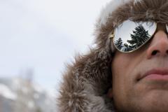 A man wearing a deerstalker hat and sunglasses Stock Photos