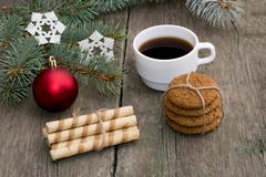 Coniferous branch, two linking of cookies and coffee Stock Photos