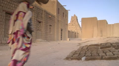 Mali Timbuktu Woman and Child Walking Down the Street Stock Footage