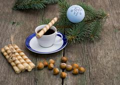 Coniferous branch, coffee, linking of cookies and nutlets Stock Photos
