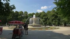 Selling ice cream next to the fountain of Saxon Garden, Warsaw Stock Footage