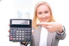 Pleasant businesswoman holding calculator Stock Photos