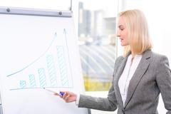 Professional businesswoman being busy at work - stock photo
