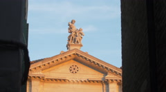 Two statues on top of a building in Venice Stock Footage